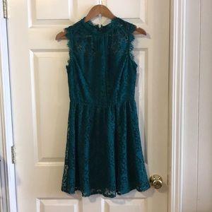 Dresses & Skirts - Dark green lace dress.